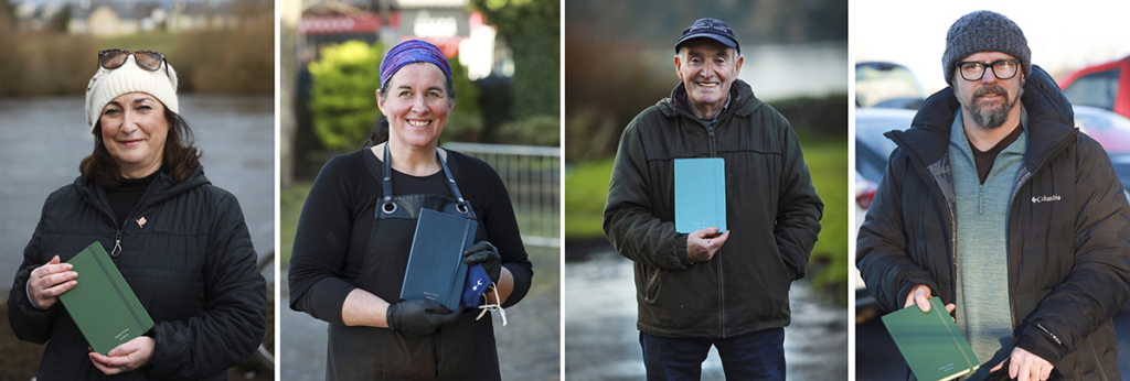 4 people holding notebooks